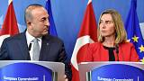Turkish foreign minister in Brussels amid protests over activists' arrests