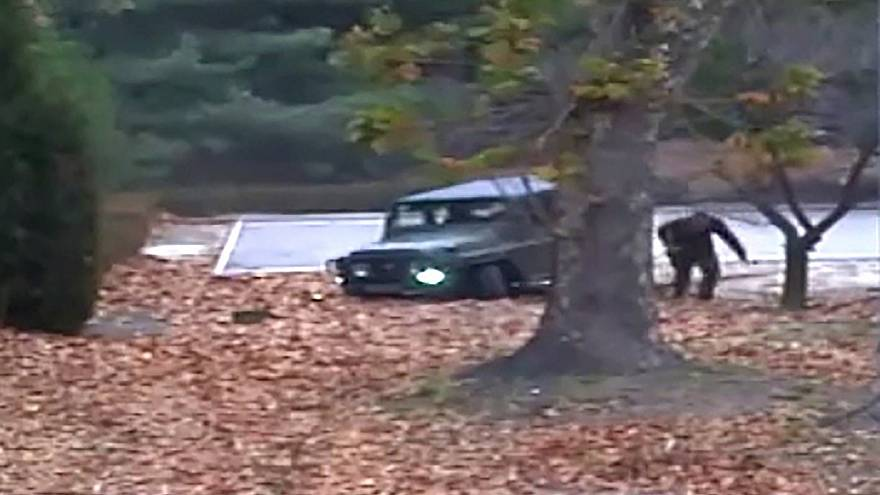 Image: A North Korean defector running out from a vehicle at the Joint Secu