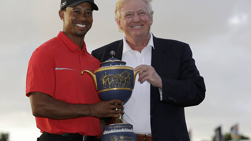 Image: Tiger Woods and Donald Trump pose for photos at the Cadillac Champio