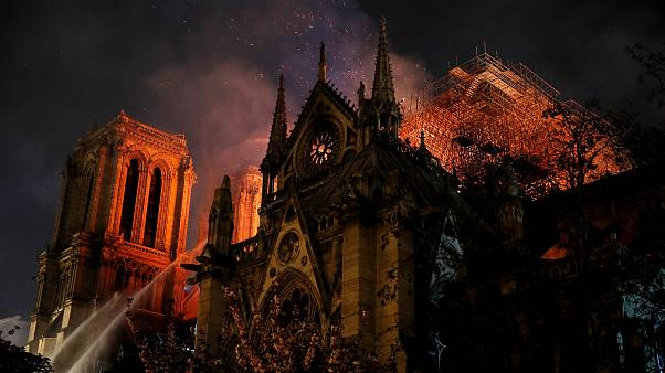 Image: Firefighters continue to extinguish flames at the Notre Dame Cathedr