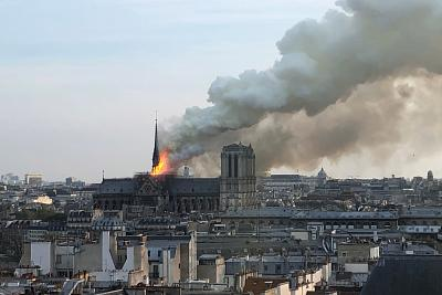The roof of Notre Dame Cathedral burns on Monday.