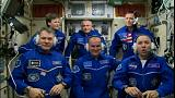 Astronauts safely join ISS