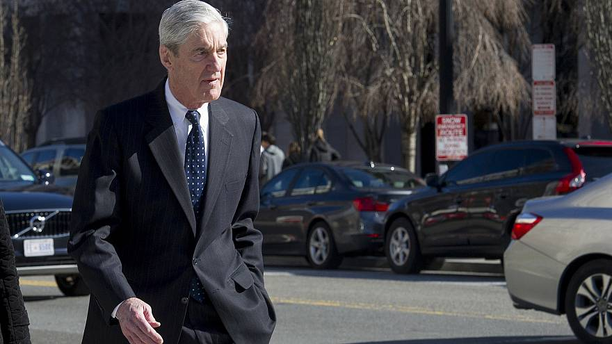 Image: Special Counsel Robert Mueller walks to his car after attending serv