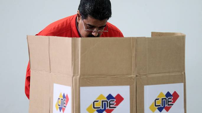Opposition parties boycott as Venezuela's president Madura votes