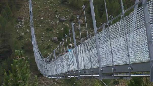 'World's longest' pedestrian suspension bridge opens in Switzerland