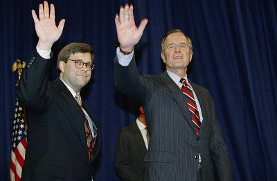 President George H.W Bush and William Barr wave after Barr was sworn in as Attorney General in Washington on Nov. 26, 1991.
