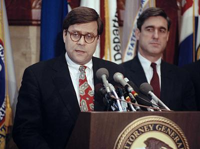 Attorney General William Barr speaks with reporters at a news conference in Washington on Dec. 19, 1991. Standing next to Barr is Assistant Attorney General Robert Mueller.