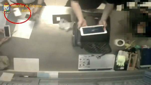 Watch: Baggage handlers in Italy 'caught stealing' from travellers' luggage