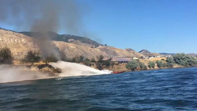 Watch: Speedboat uses its power to fight wildfire