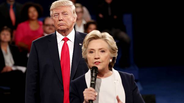 Image:Donald Trump listens as Hillary Clinton answers questions during a de