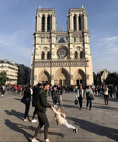 Brooke Windsor took a photo of a father and daughter dancing outside the Notre Dame before a fire broke out at the cathedral on April 15, 2019.