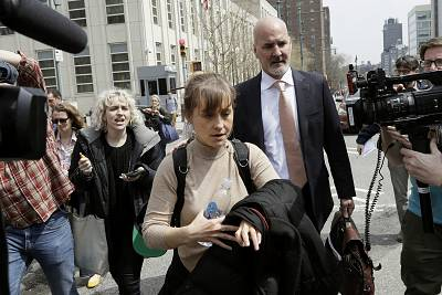 Actress Allison Mack leaves Brooklyn federal court on April 8 in New York.