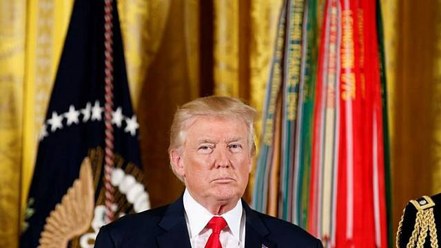 Donald Trump signs Russian sanctions bill into law