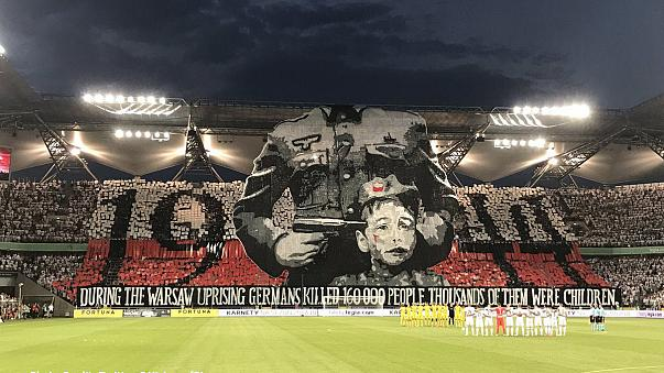 Football fans unfurl provocative World War II banner