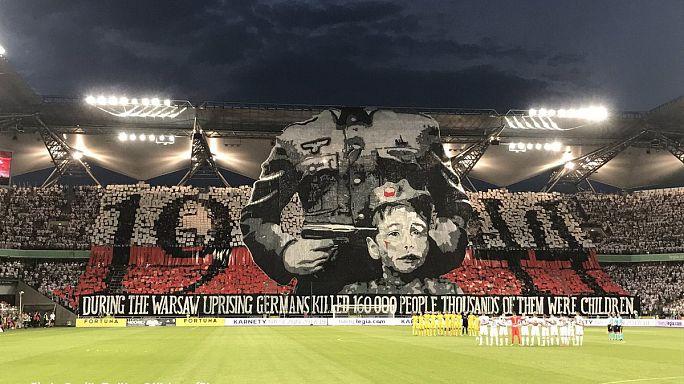 Football fans unfurl provocative World War II banner