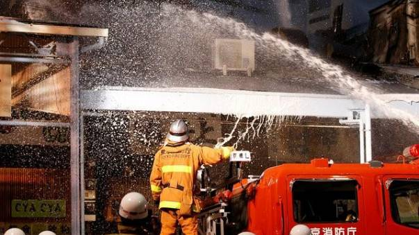 Tokyo firefighters tackle a blaze at world's largest fishmarket.