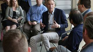 Image: Howard Schultz speaks during a town hall on the University of Kansas