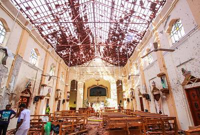 Officials inspect St. Sebastian\'s Church in Negombo, Sri Lanka, after Sunday\'s explosion.