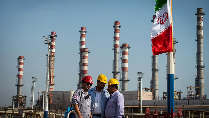 Image: Employees at a facility at the Persian Gulf Star Co. gas refinery in