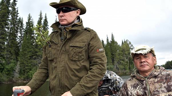 No one knows why Vladimir Putin is wearing a twig in his pocket