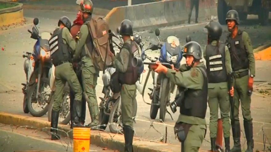 Venezuela eyetwitness: 'The policeman pointed his gun and shot me'