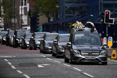 The coffin of journalist Lyra McKee arrives at her funeral at St. Anne\'s Cathedral in Belfast, Northern Ireland April 24, 2019.