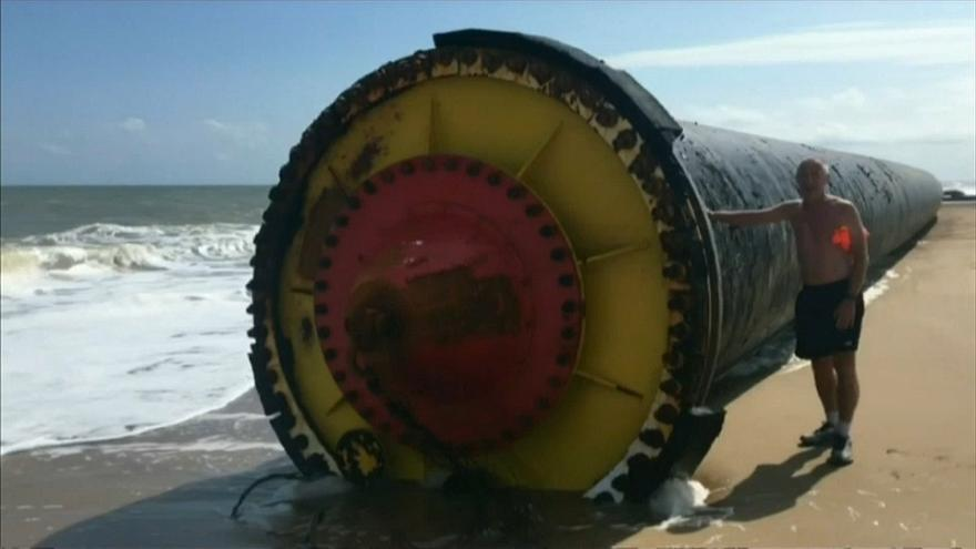 Giant pipes wash up on UK beach