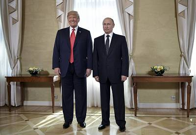 President Donald Trump and Russian President Vladimir Putin, right, pose for a photograph at the Presidential Palace in Helsinki, Finland, on July 16, 2018.