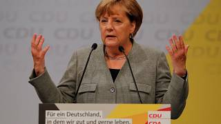 Merkel slams German auto execs during election rally