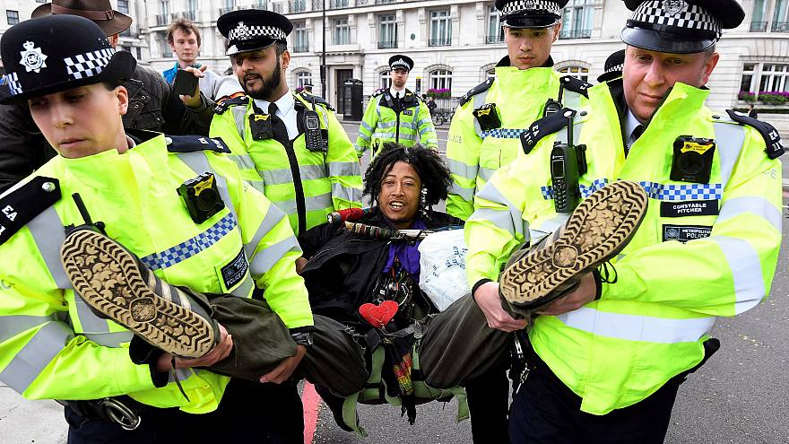 Image: Members of the police carry a demonstrator during the Extinction Reb