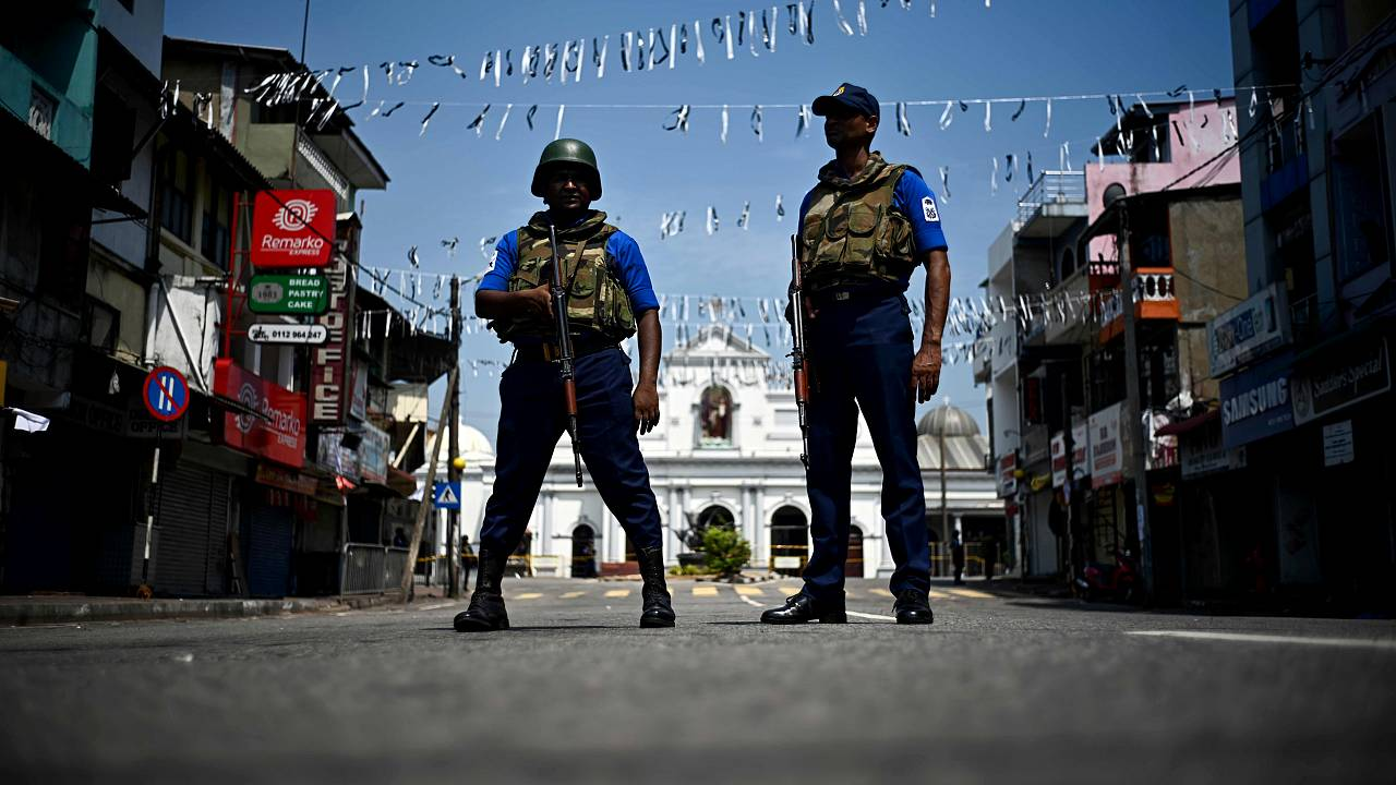 Image: Security personnel stand guard near St. Anthony's Shrine three days