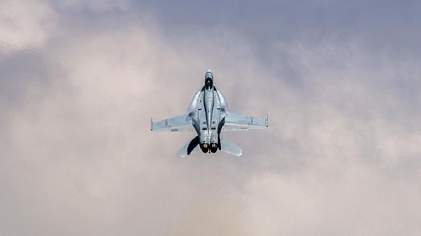 Image: An F/A-18 Super Hornet executes tactical maneuvers at an air show at