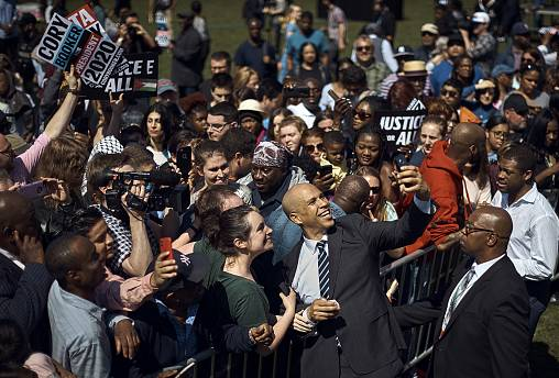 Image: Sen. Cory Booker, D-NJ, takes a selfie with supporters during his ca