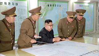 North Korea delays decision to launch Guam attack