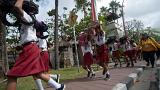 Duck and cover: Indonesian children take part in tsunami drill