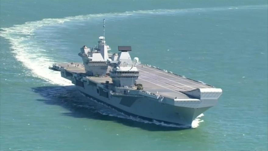 Britain's new warship, HMS Queen Elizabeth, heads for Portsmouth