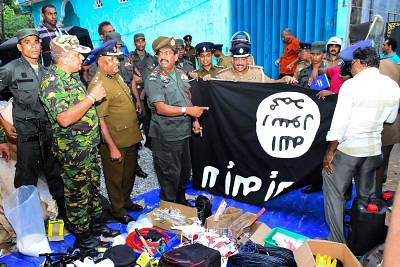 In this picture taken on April 26, 2019, security personnel inspects seized items after they raid what believed to be an Islamist safe house in the eastern town of Kalmunai. - Fifteen people, including six children, died during a raid by Sri Lankan security forces as three cornered suicide bombers blew themselves up and others were shot dead, police said on April 27. (Photo by STRINGER / AFP)STRINGER/AFP/Getty Images