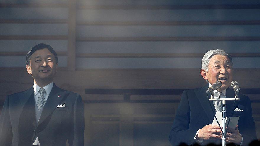 Image: Japanese Emperor Akihito, right, makes a speech as Crown Prince Naru