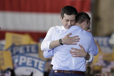 South Bend Mayor Pete Buttigieg hugs his husband, Chasten Glezman, after Buttigieg announced that he was seeking the Democratic presidential nomination.