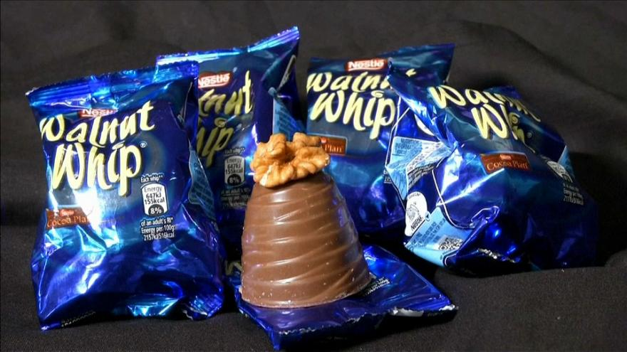 Nestle remove the walnuts from their whips.