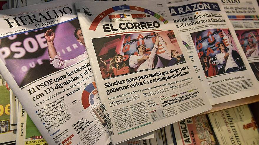 Image: Spanish newspapers in Pamplona, northern Spain, announce the victory
