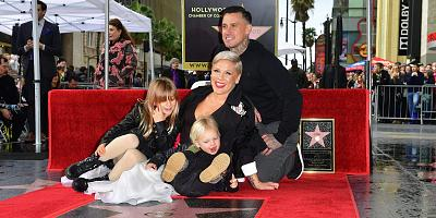 Pink poses with her husband, Carey Hart, and their children, during the singer\'s Hollywood Walk of Fame ceremony earlier this year.