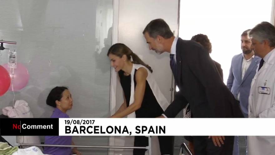 Spanish royals comfort the injured