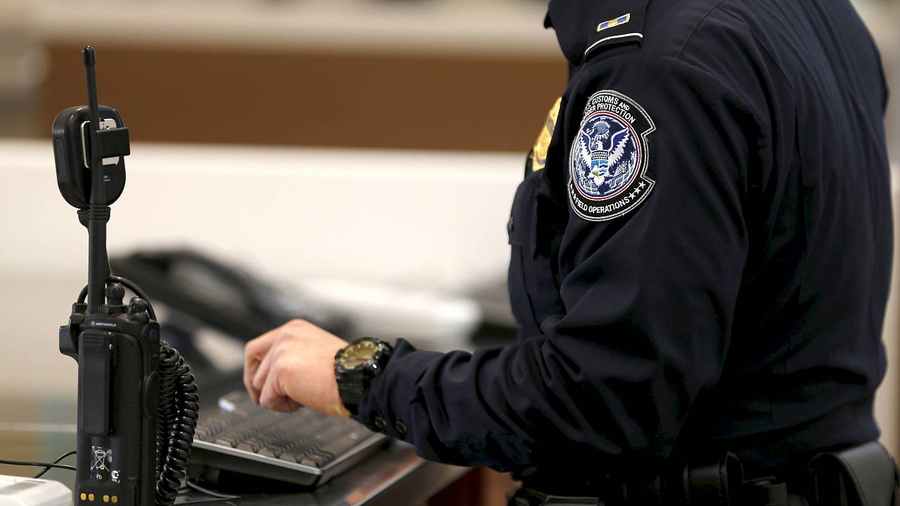 A U.S. Customs and Immigration officer works a new border crossing during t