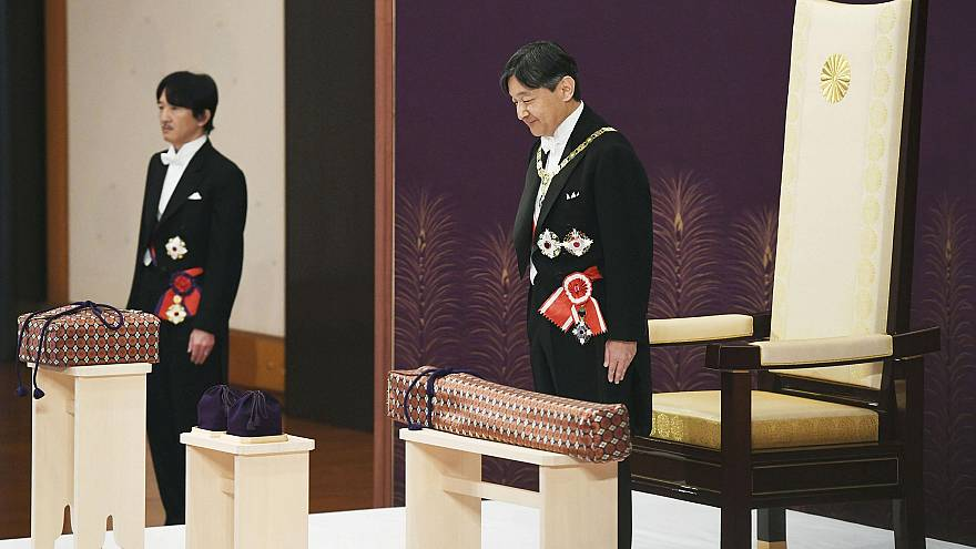 Image: Japan's Emperor Naruhito, flanked by Crown Prince Akishino, attends
