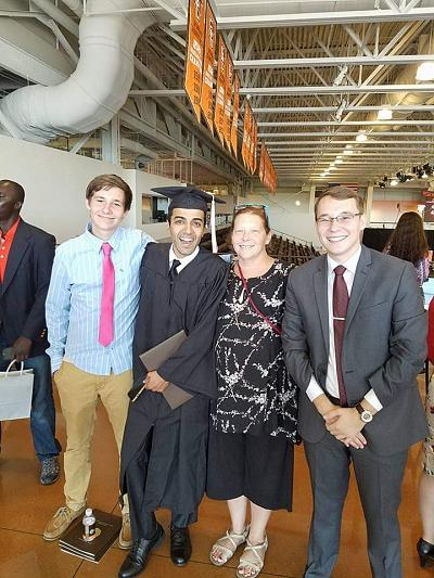 Tynan Hubbell-Staeble, Ayman al-Drees, Dawn Hubbell-Staeble and Aidan Hubbell-Staeble pose at al-Drees\' graduation from Bowling Green State University in 2016.