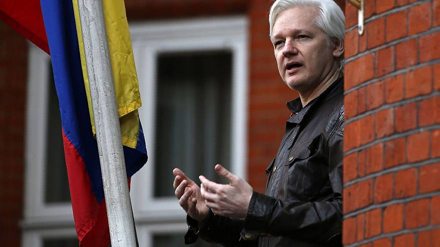 Image: Wikileaks founder Julian Assange speaks from a balcony at the Embass