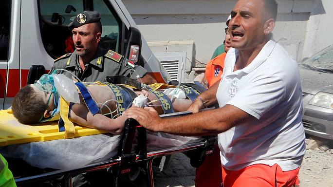 Third brother freed from debris of Italian quake