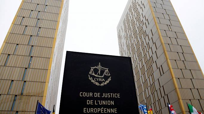 Theresa May denies Brexit U-turn over end of EU court's jurisdiction