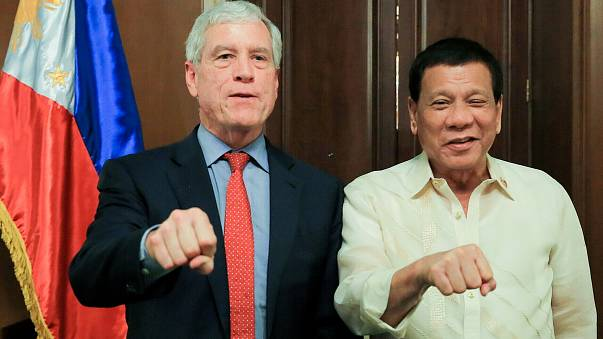 Australia defends spy chief's 'fist' salute with Philippines leader